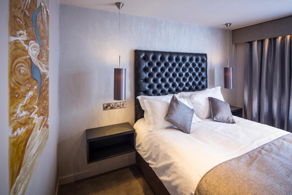 Ліжко або ліжка в номері The Enniskillen Hotel and Motel