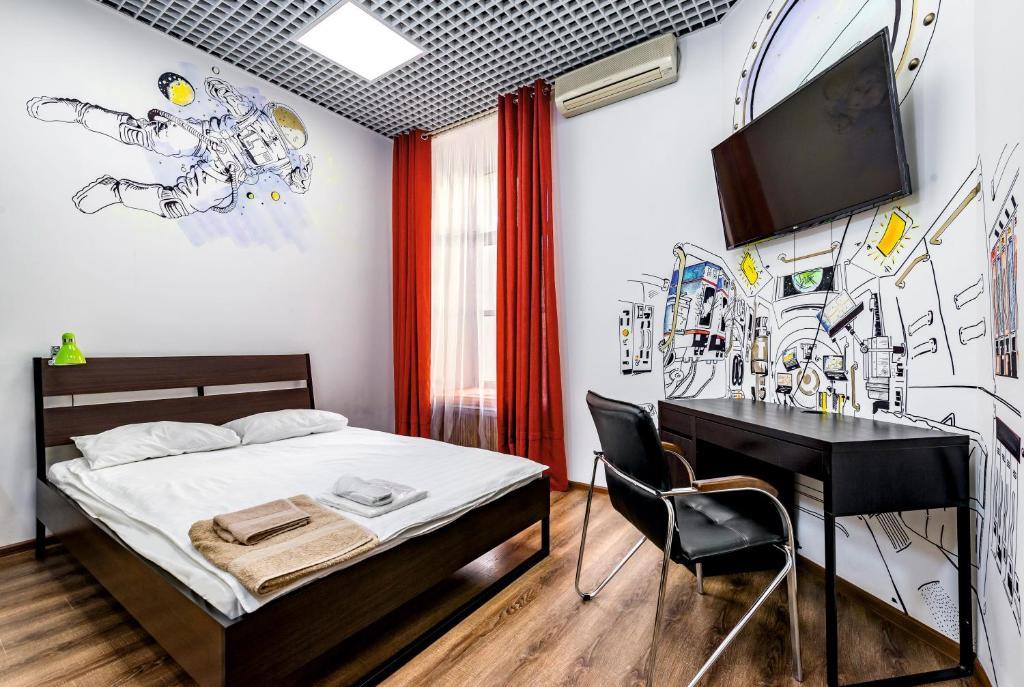 Кровать или кровати в номере Мини-отель Кутузовский