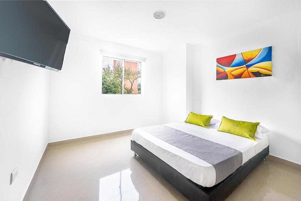 Cama ou camas em um quarto em Ayenda 1219 Park 6