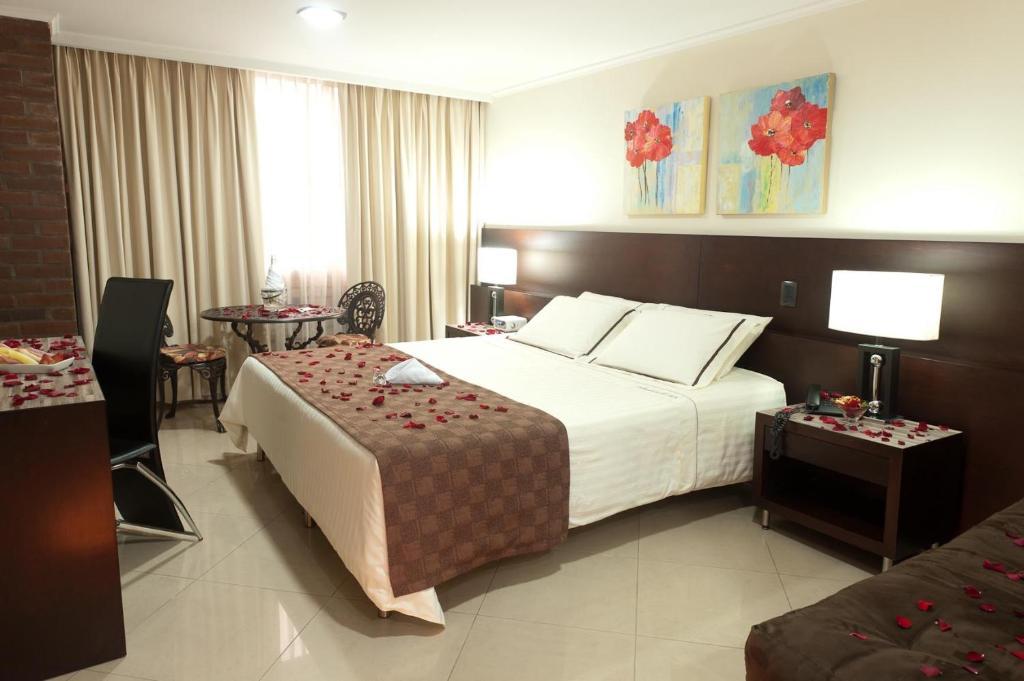 Cama o camas de una habitación en Hotel Alameda de la 10