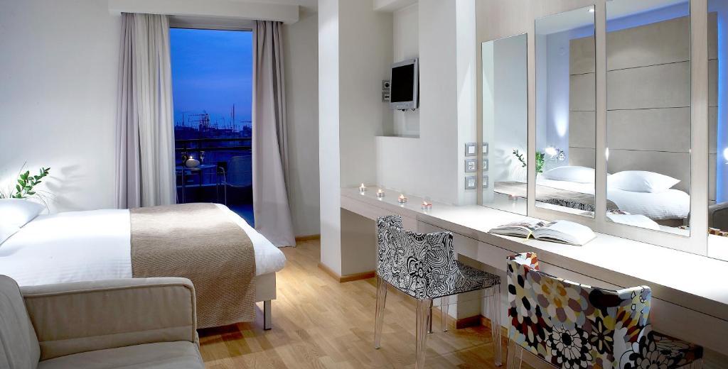 Ein Badezimmer in der Unterkunft Hotel Olympia