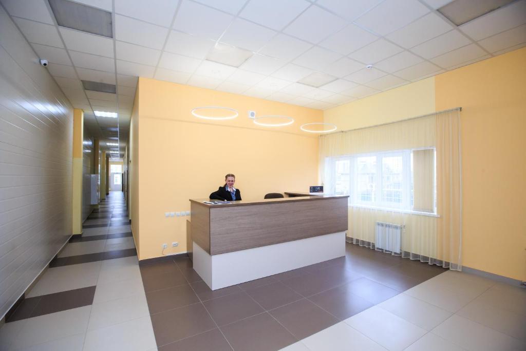 Лобби или стойка регистрации в Гостиница Лев