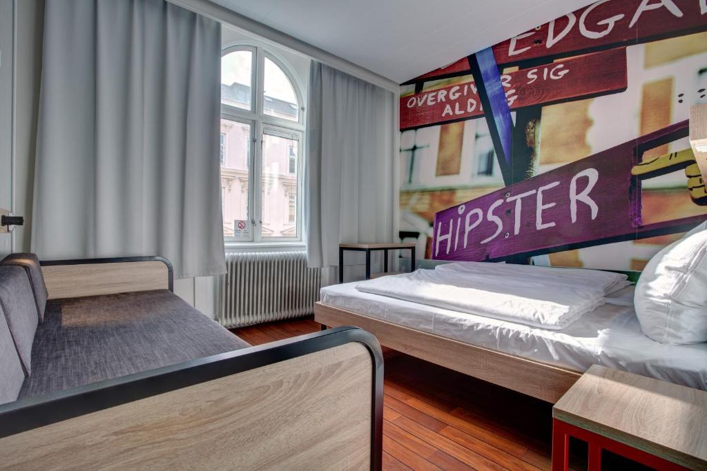 Letto o letti in una camera di Urban House Copenhagen by MEININGER
