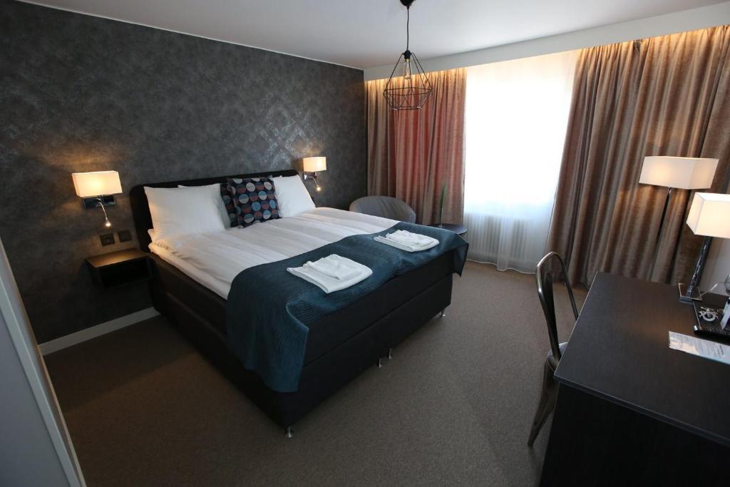 Säng eller sängar i ett rum på Hotell Rättvik