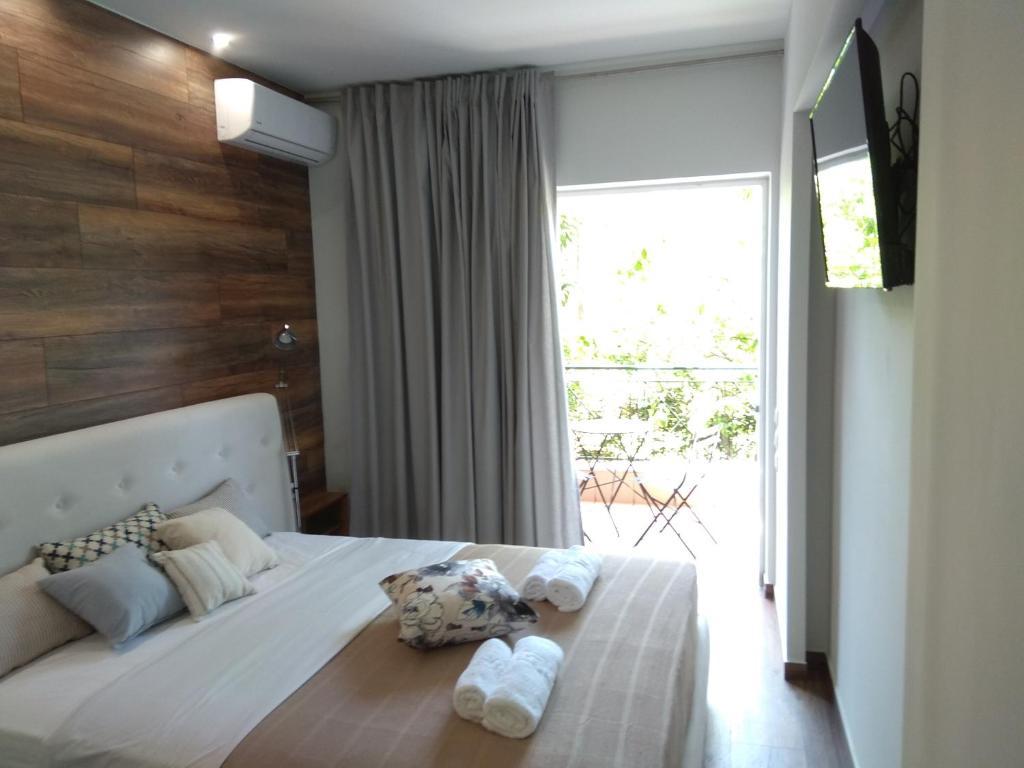 Łóżko lub łóżka w pokoju w obiekcie Limonchello