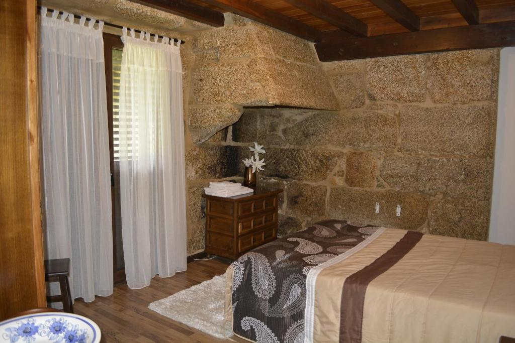 A bed or beds in a room at CASA DA LÚA