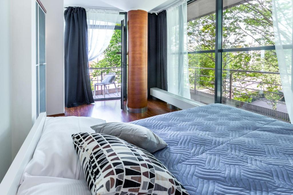 Een bed of bedden in een kamer bij Aparthotel Friendhouse