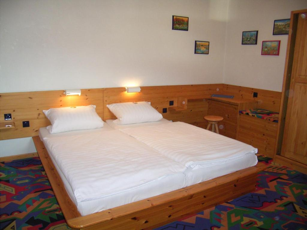 A bed or beds in a room at Smile Hotel
