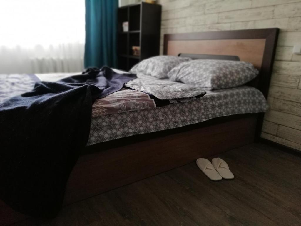 Кровать или кровати в номере Apartment Na Ostrovskogo