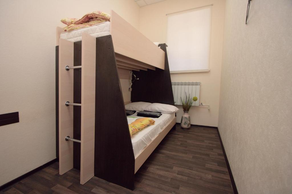 A bunk bed or bunk beds in a room at Business Blizzzko Hostel