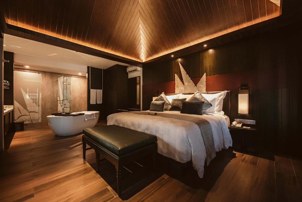 A bed or beds in a room at The Vira Bali Boutique Hotel & Suite