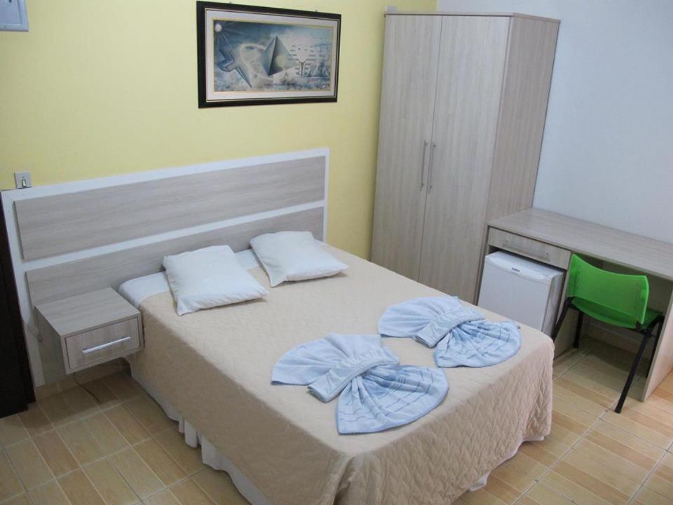 Cama ou camas em um quarto em Hotel Piramide