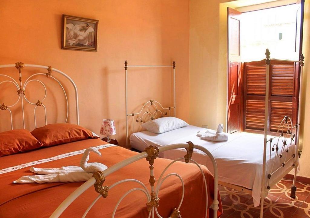 Cama o camas de una habitación en Hostal German 1806