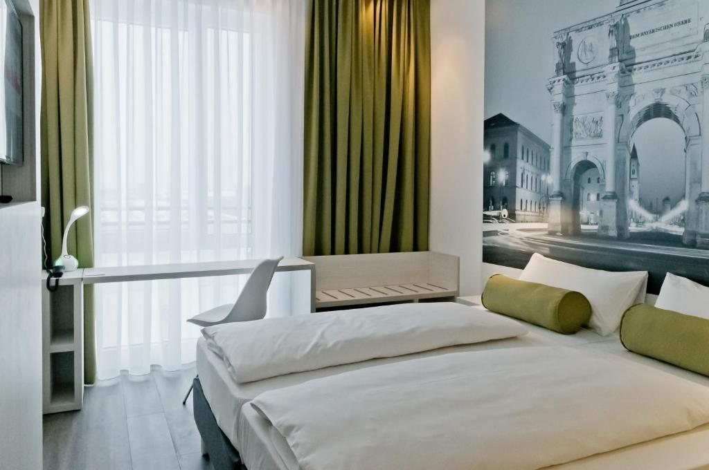 A bed or beds in a room at Super 8 by Wyndham Munich City West