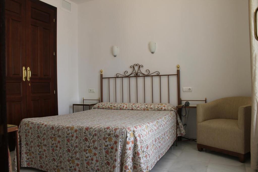 Ein Bett oder Betten in einem Zimmer der Unterkunft Don Paula