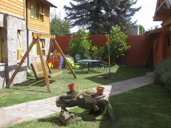 Zona de juegos para niños en Apart Hotel Tierra Nativa