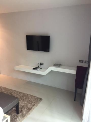 A television and/or entertainment center at Emerald Terrace By Rents In Phuket