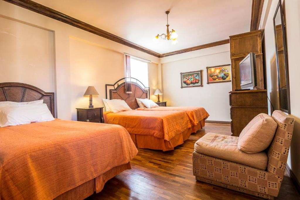 A bed or beds in a room at Viejo Olivo B&B