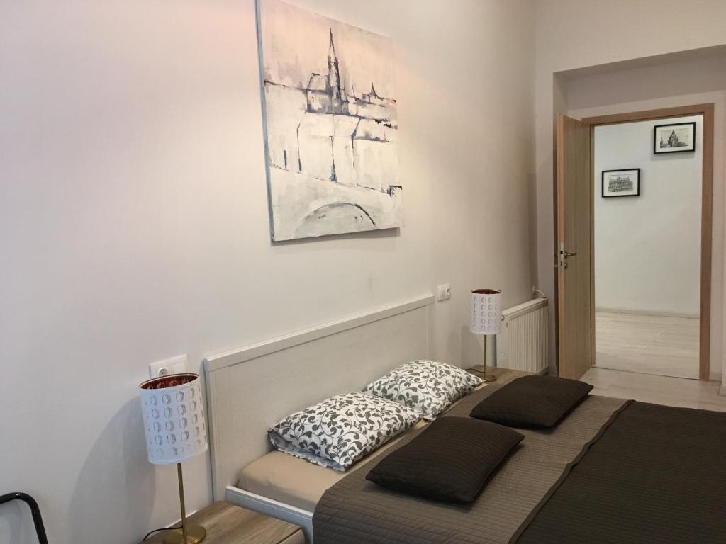Кровать или кровати в номере Goldcentral Apartment Dob