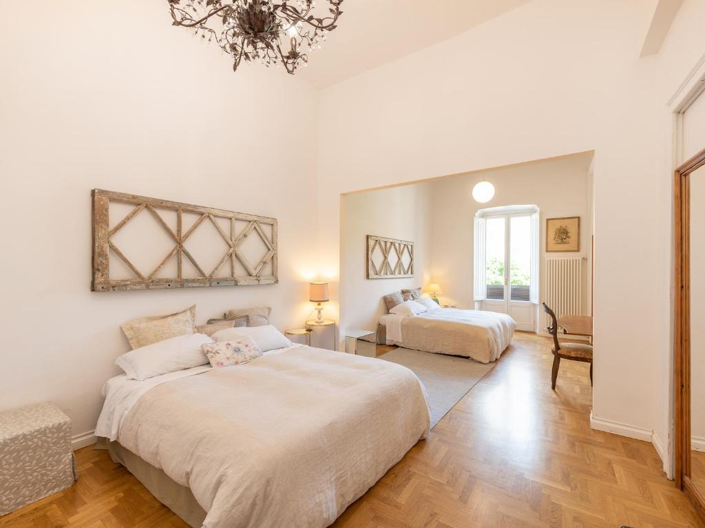 Кровать или кровати в номере Sardinia Home Design