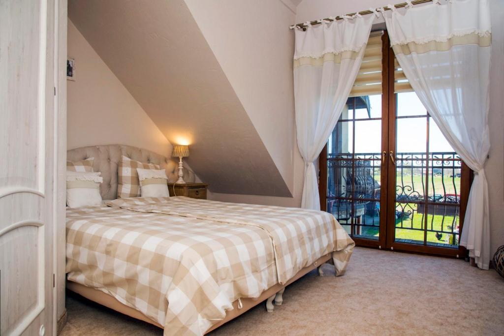 Ein Bett oder Betten in einem Zimmer der Unterkunft Feniks Agro&Spa Adults Only
