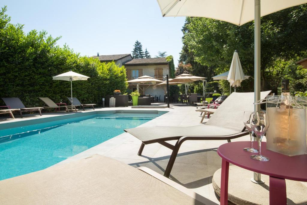 The swimming pool at or near Logis Hotel Le Petit Casset