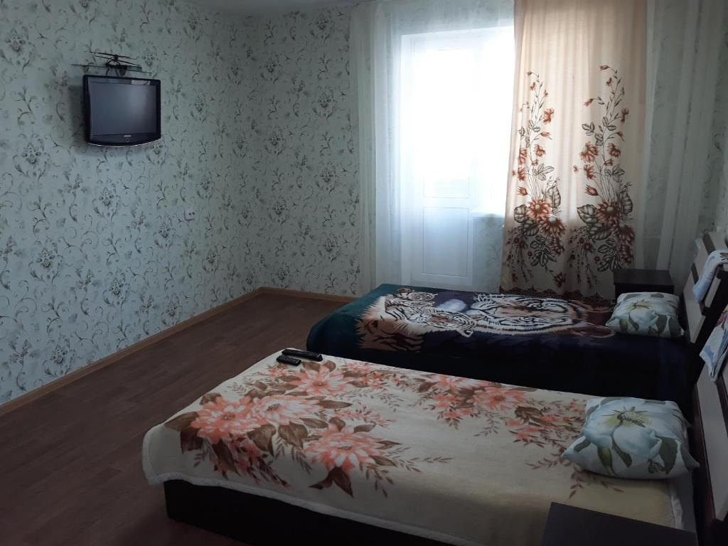 Кровать или кровати в номере гостиница Иловлинская