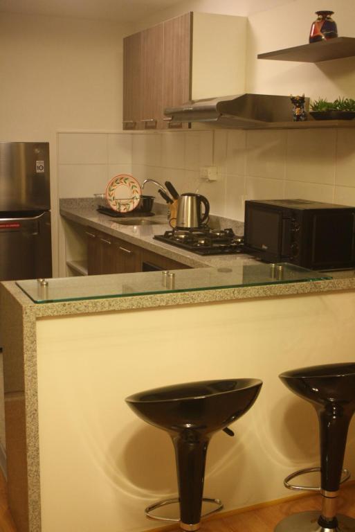 A kitchen or kitchenette at Apartamento en Barranco