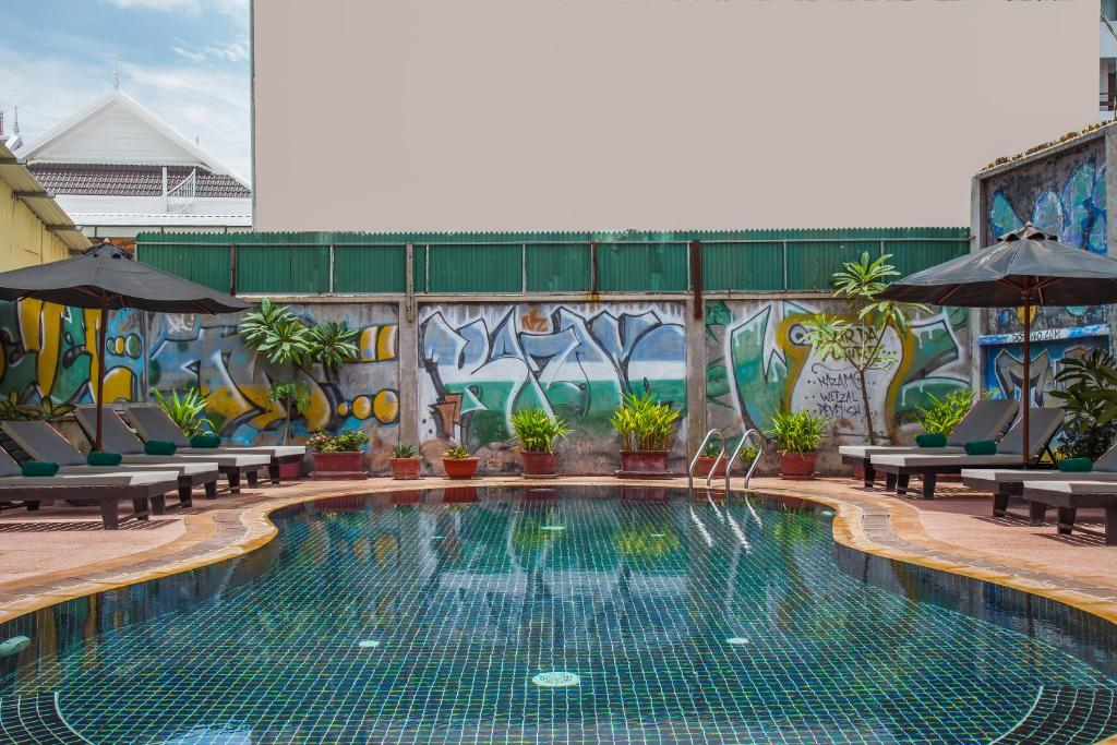 The swimming pool at or near Side Walk Hotel