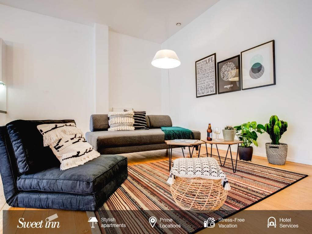 Coin salon dans l'établissement Sweet Inn Apartments - Châtelain