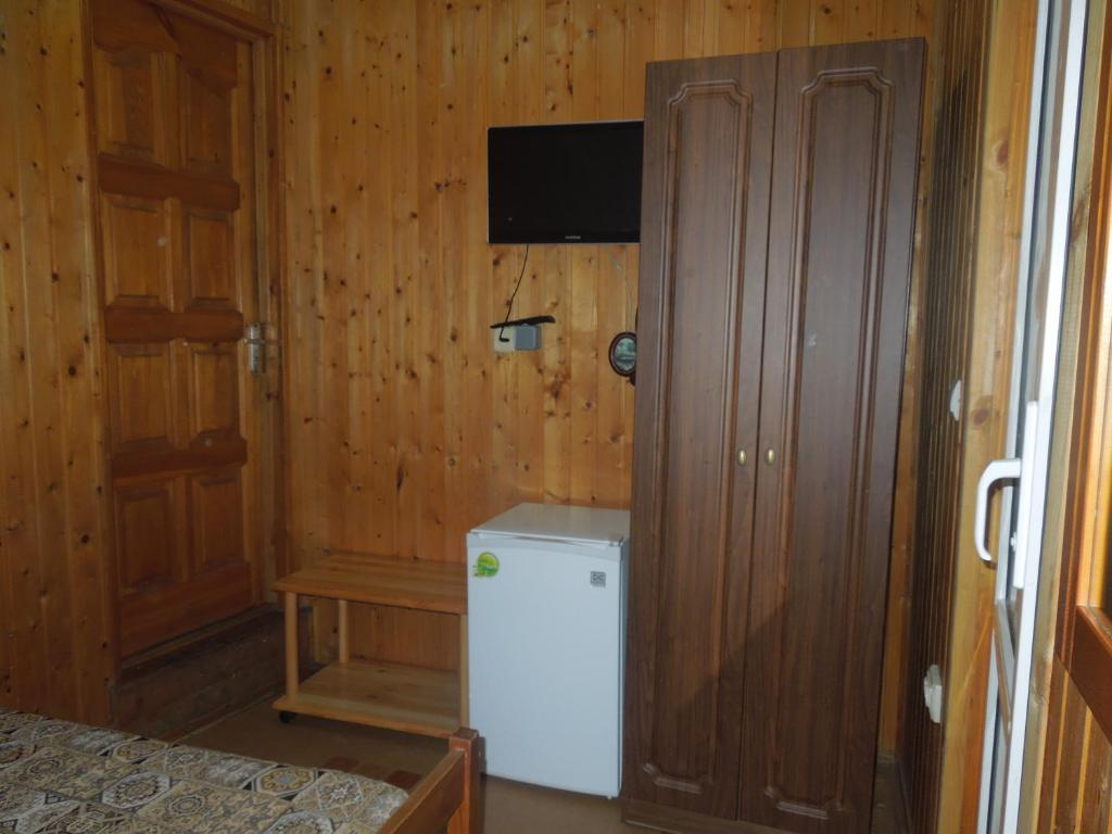 A television and/or entertainment center at Guest House Avangard