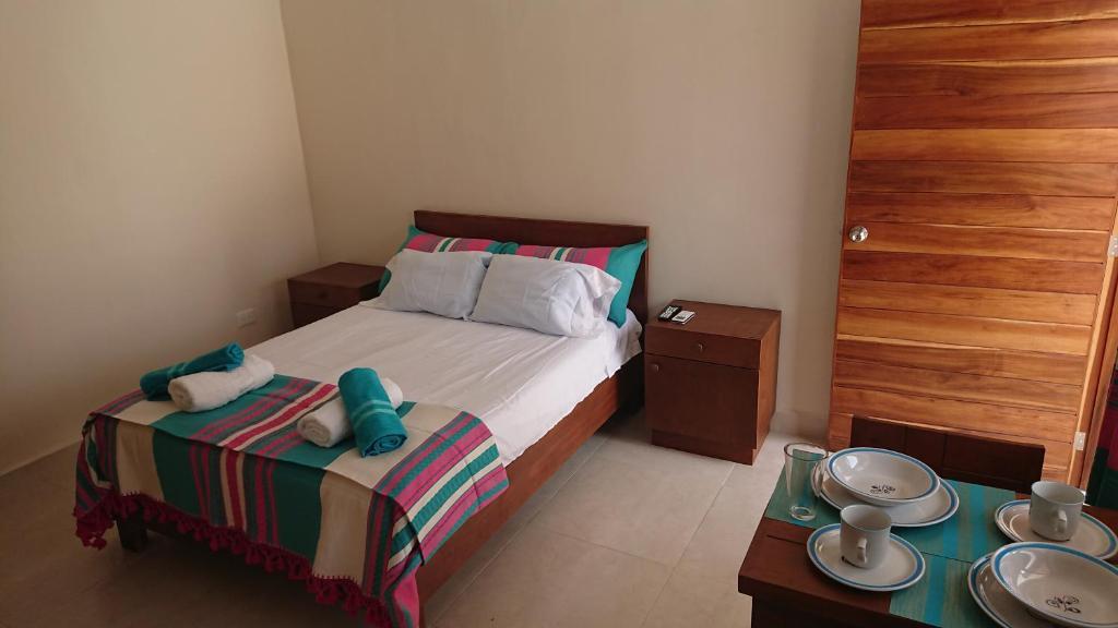 מיטה או מיטות בחדר ב-Maya Inn