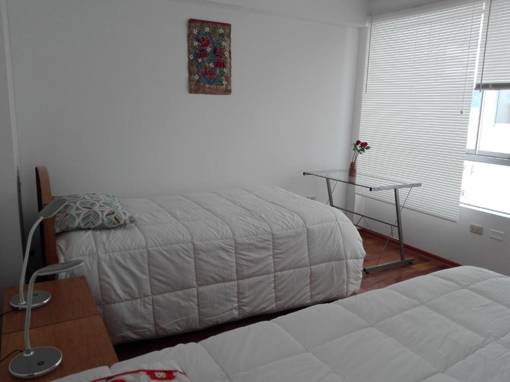 Cama o camas de una habitación en Cuatro Gatos Privado