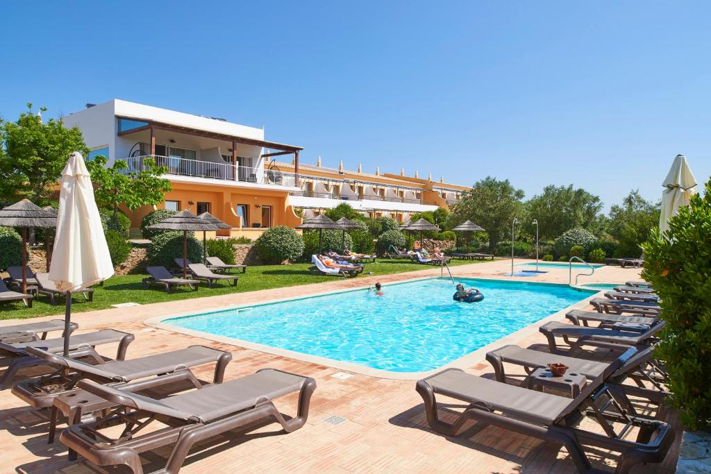 The swimming pool at or near Hotel Rural Quinta do Marco - Nature & Dining