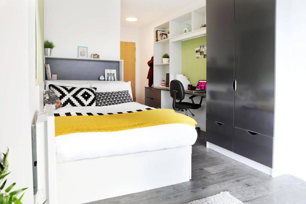 A bed or beds in a room at Aparto - Binary Hub