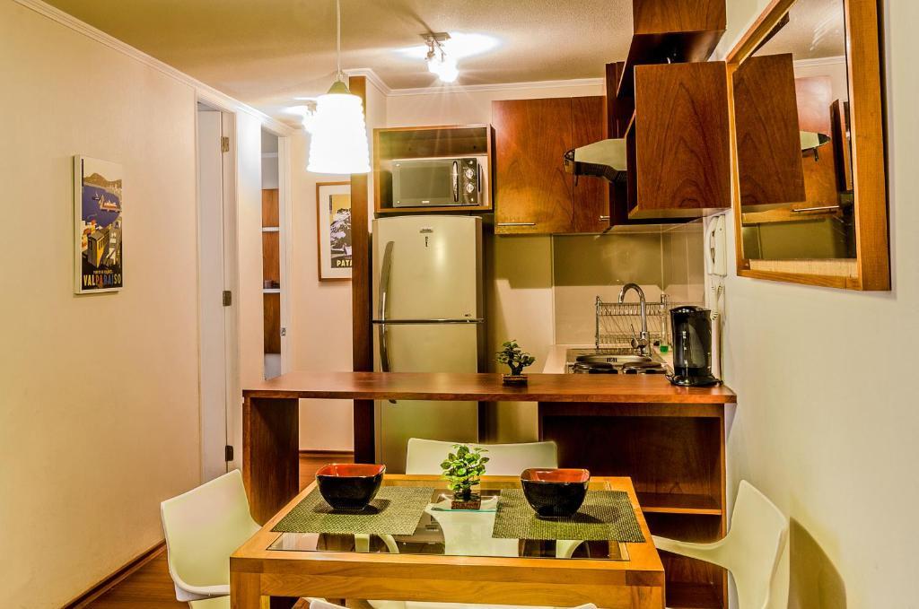 Una cocina o zona de cocina en Departamentos Alto Moneda