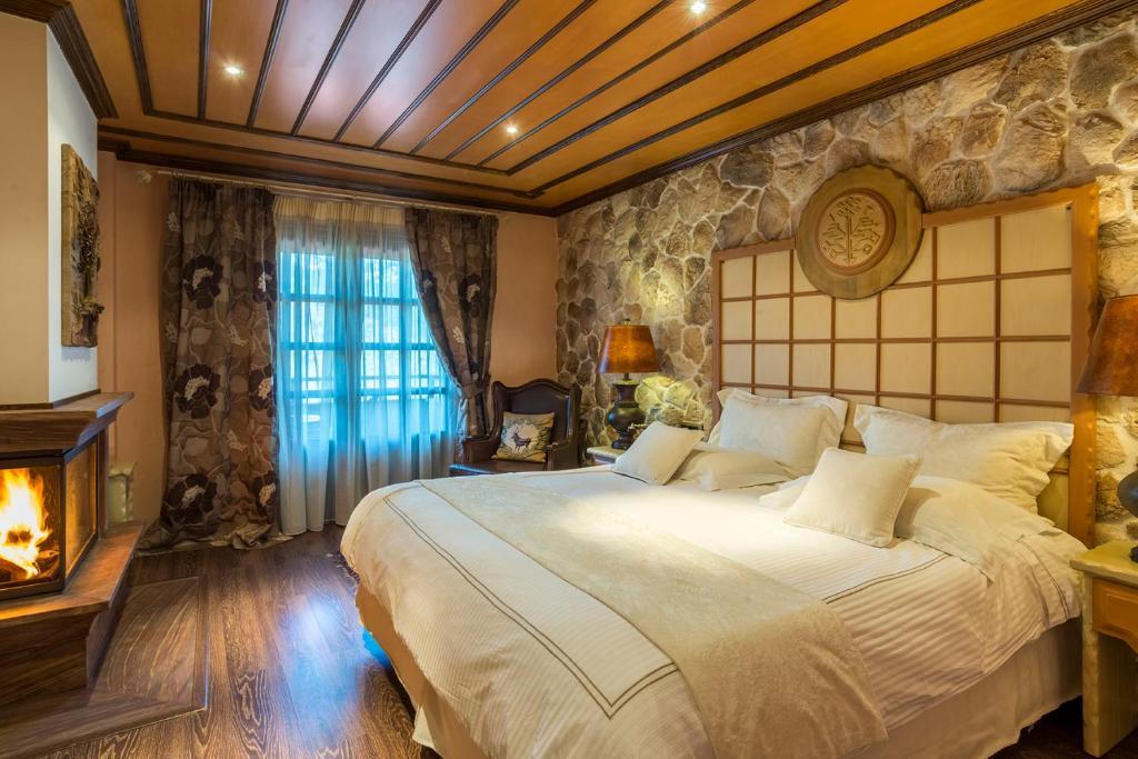 Ένα ή περισσότερα κρεβάτια σε δωμάτιο στο Aroma Dryos Eco & Design Hotel