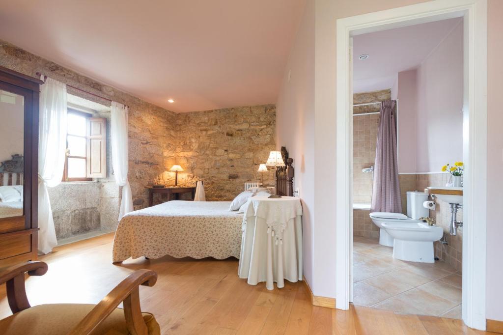 Cama o camas de una habitación en Casa Rural de Graña da Acea