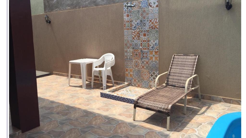 A seating area at Sua casa fora de casa