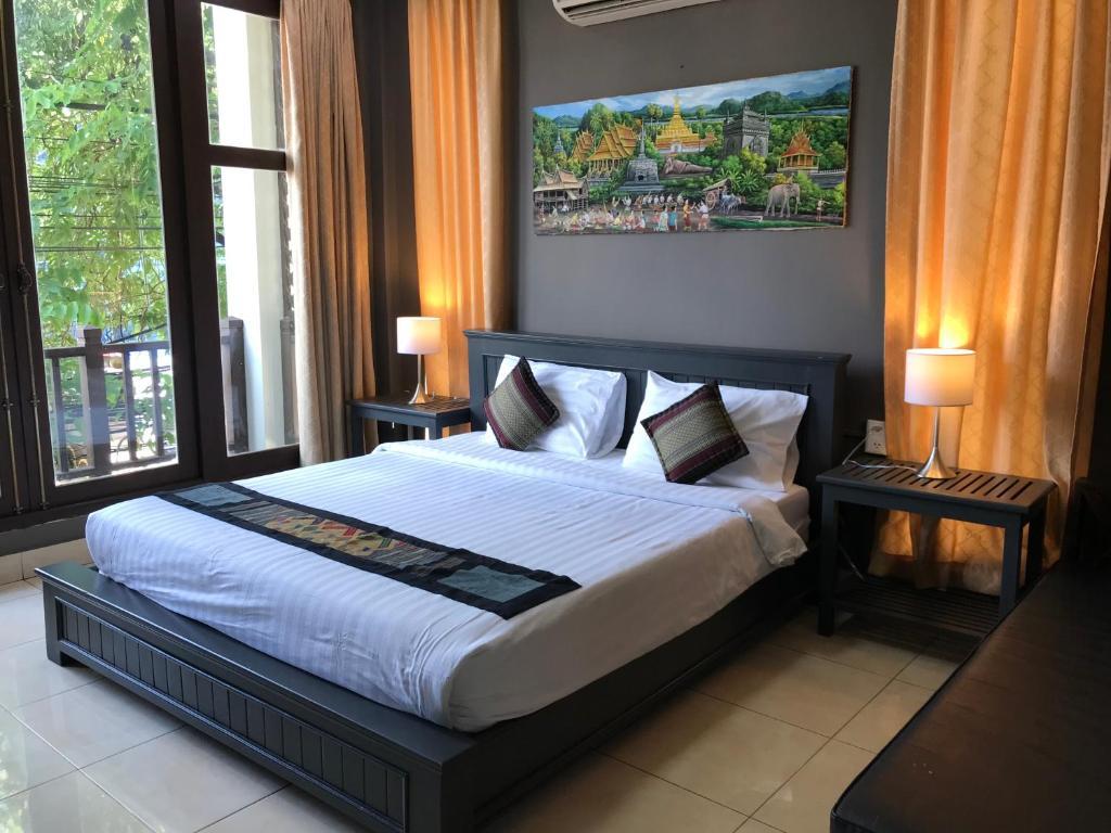 Ein Bett oder Betten in einem Zimmer der Unterkunft VKS Hotel