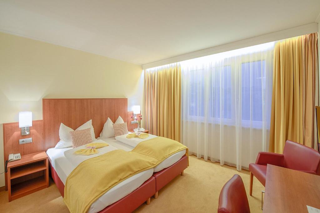 Ein Bett oder Betten in einem Zimmer der Unterkunft Wachauerhof