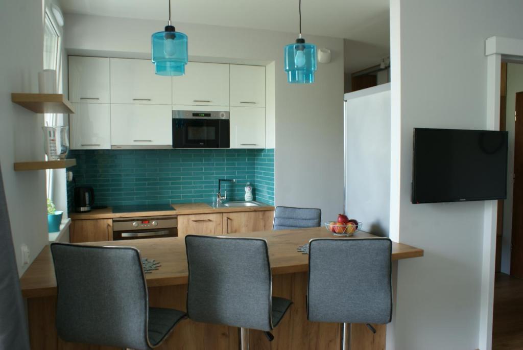 A kitchen or kitchenette at Apartament 88
