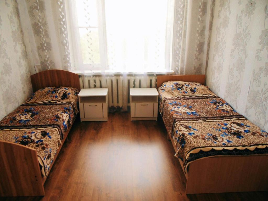 Кровать или кровати в номере Квартира для семьи