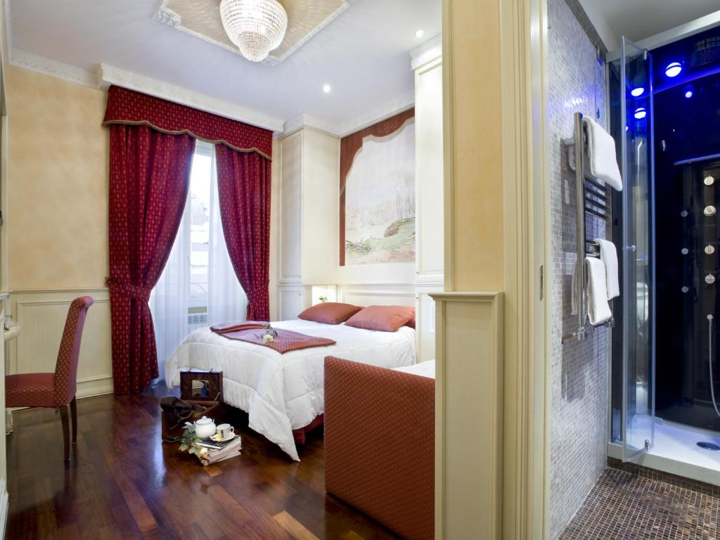 A bed or beds in a room at Al Viminale Hill Inn & Hotel