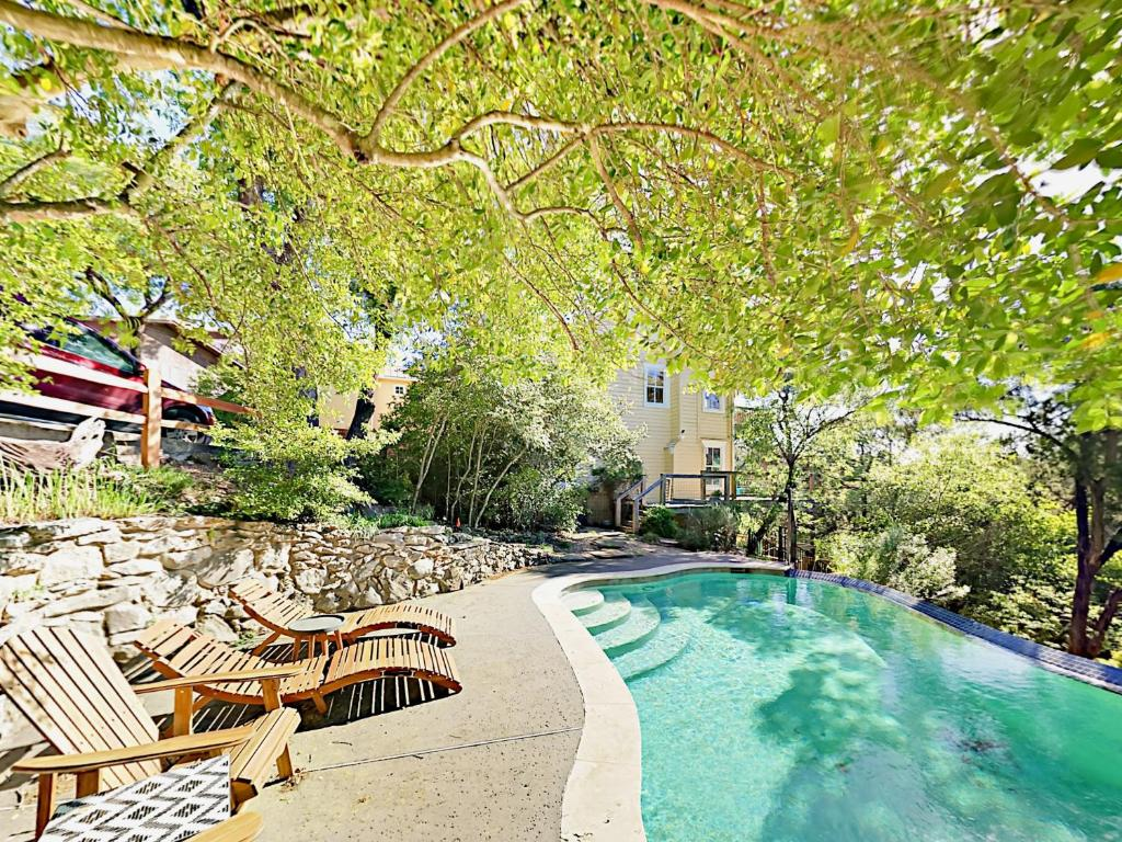 A view of the pool at 805 The High Road Home or nearby