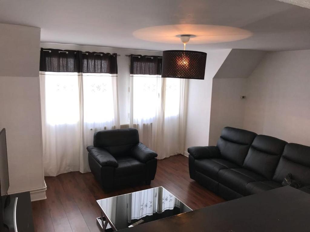 Coin salon dans l'établissement Appartement coeur de ville