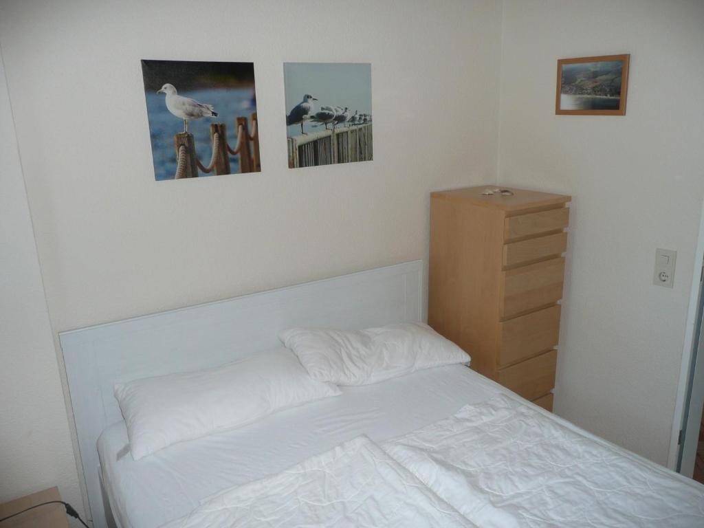 A bed or beds in a room at Seestern