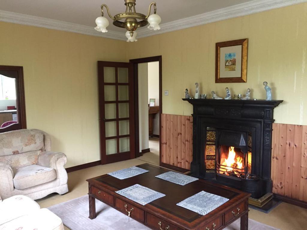 A seating area at Listamlet Grange Bungalow