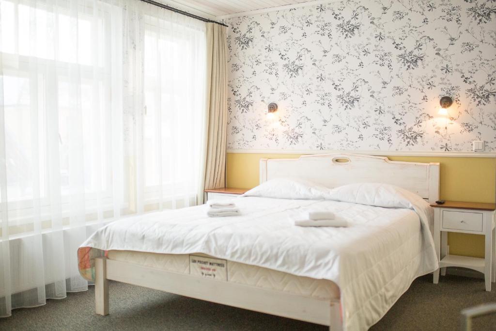 Gulta vai gultas numurā naktsmītnē Vanalinna Hotel