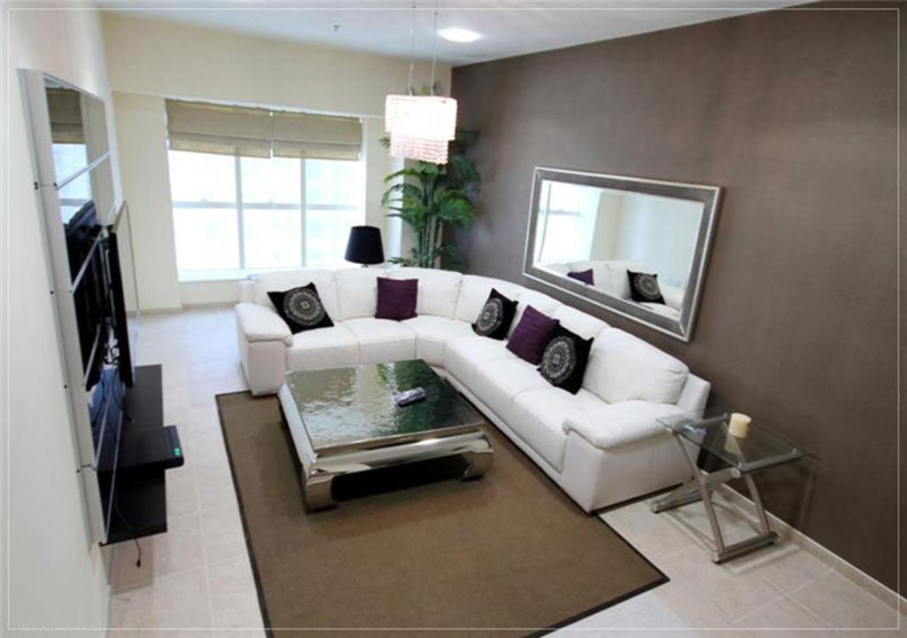 A seating area at Furnished Rentals - Elite Residence Tower, Dubai Marina